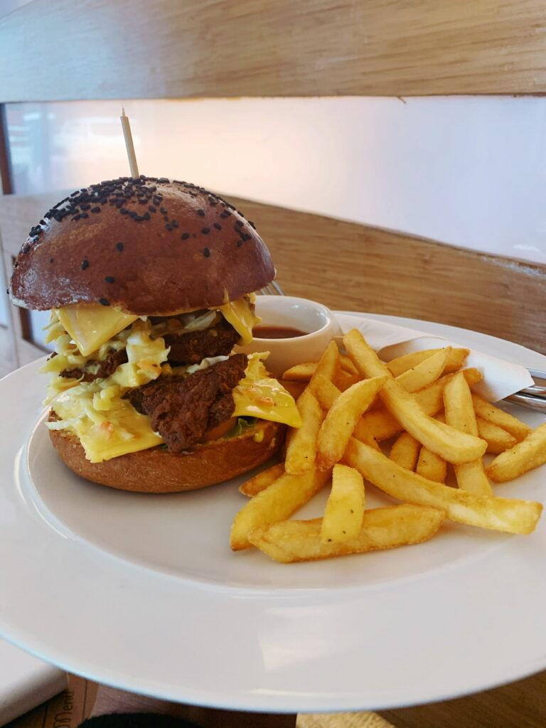 Crispy chicken burger at corner store cafe